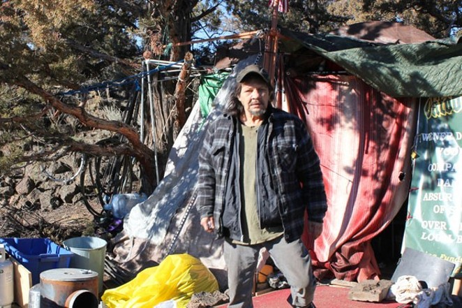 Jon Atkins stands outside of his tent at Juniper Ridge in northeast Bend. - LAUREL BRAUNS