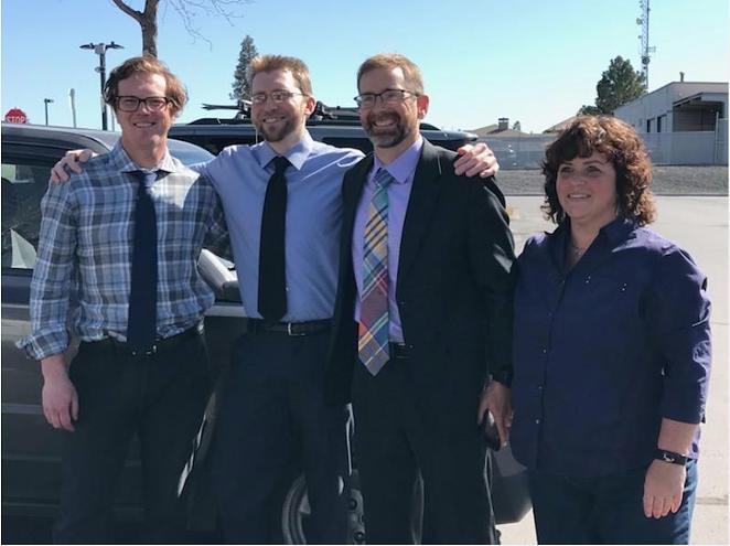 Luke Wirkkala on the day of his release. From left to right: attorney Thaddeus Betz, Luke Wirkkala, attorney Joel Wirtz and investigator Vicki Kipp. - COURTESY OF LUKE WIRKKALA