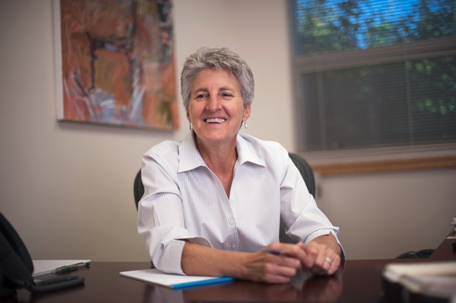 Dr. Becky Johnson sits at her desk for a photo taken for Oregon State University's College of Business Magazine. - COURTESY OF OREGON STATE UNIVERSITY — CASCADES