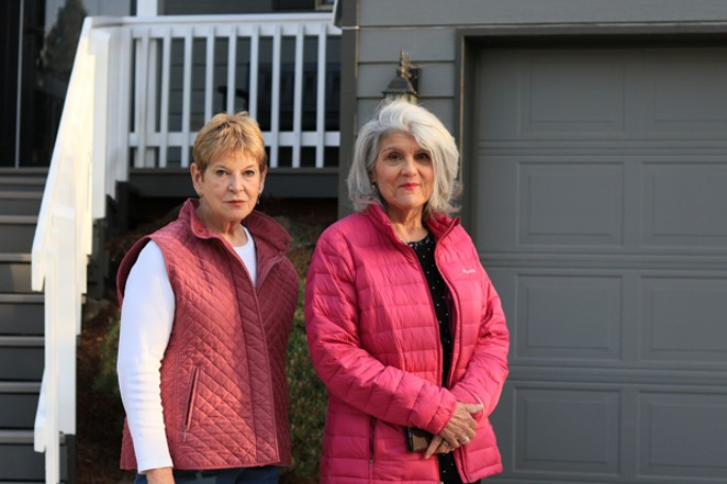 Jan Shamberg and Michelle Knowles stand outside of the garage where they gathered people around the neighborhood to get their signatures notarized to block a Type 2 vacation rental permit. - JACK HARVEL