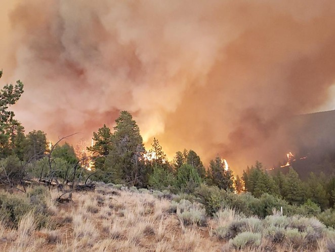 Smoke and flames from the Grandview Fire rise over the horizon on July 11. - INCIWEB