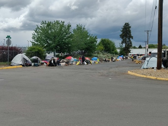 Camps line both sides of Emerson Avenue in Bend. On Wednesday, June 2, Bend City Council adopted policies that set criteria for the camp's removal. - JACK HARVEL