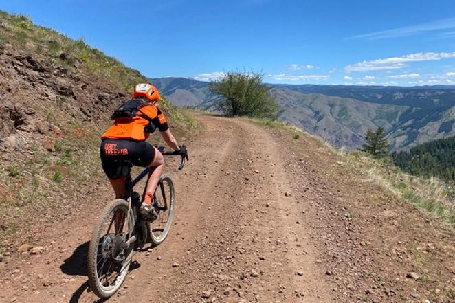 Linda English pedals up a gravel inclineoutside of Joseph, Oregon. - COURTESY LINDA ENGLISH