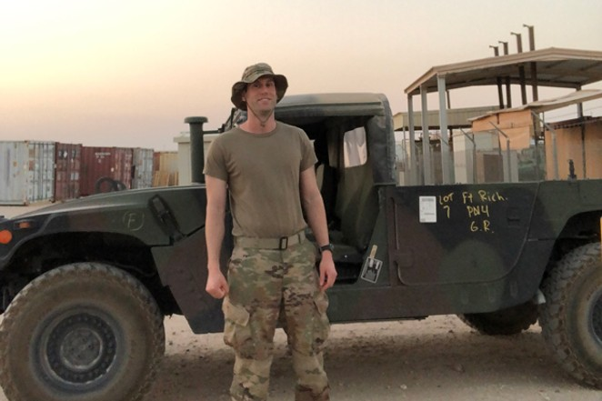 In a moment of calm Chris Browning basks in the triple-digit heat in Kuwait. - CHRIS BROWNING