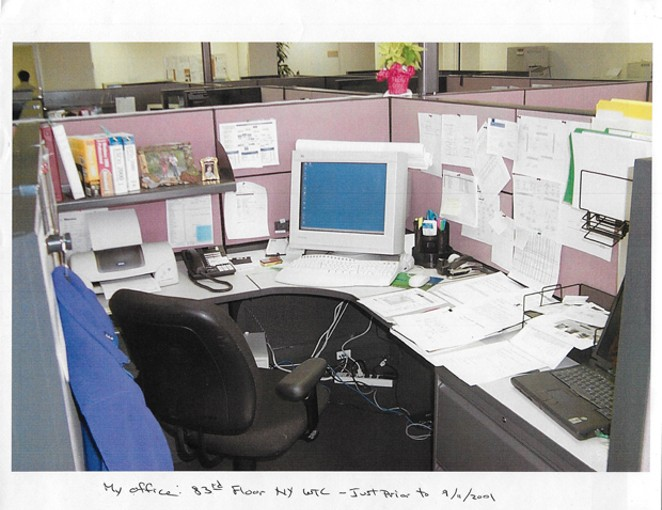 """Chuck Allen's desk at his office on the 83rd floor of the World Trade Center. """"I thought to myself, well, they probably won't let us back in the building this afternoon, So, I better take my backpack,"""" he recalled thinking after the first plane struck. - COURTESY OF CHUCK ALLEN"""