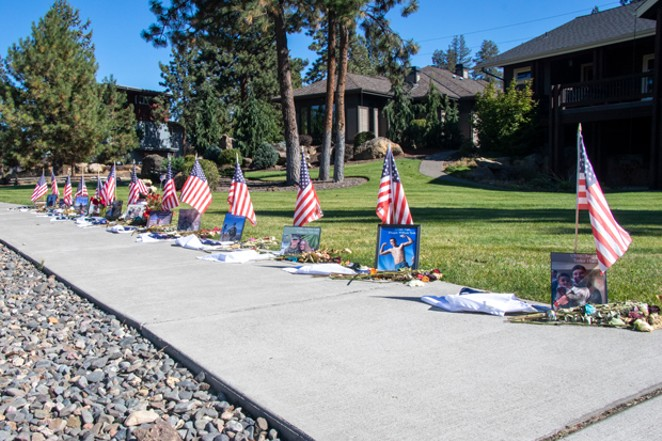 An impromptu memorial was erected on Reed Market Road across from Farewell Bend Park to memorialize the 13 U.S. Service Members killed in an attack at the Kabul Airport last month. - JACK HARVEL