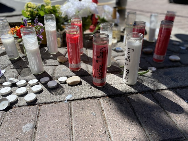"""Candles read """"Justice for Barry"""" at the memorial on Wall St. and Oregon Ave. in downtown Bend. Friends and family want to see a harsher charge for the alleged shooter, who faces second-degree manslaughter charges. - NICOLE VULCAN"""