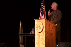 City of Sisters Mayor Chuck Ryan introduces Senator Ron Wyden at a town hall in Sisters Monday evening. - NICOLE VULCAN