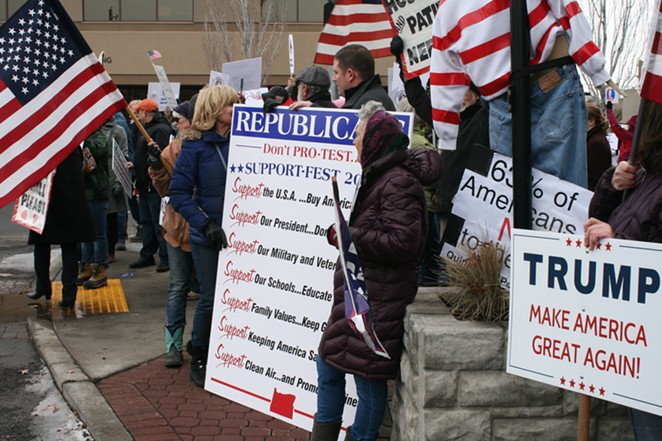 Patty Adair, at left of the large sign, campaigned for Trump during the 2016 election season. - NICOLE VULCAN