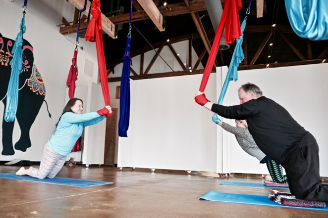 AIReal instructor Mandy Butera, left, leads Source staffers Magdalena Bokowa and Richard Sitts through the motions. - NICOLE VULCAN