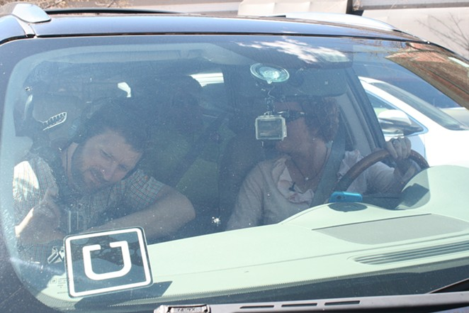 An Uber driver pulls out of an angled parking spot in downtown Bend Wednesday, taking Bend and Redmond's mayors for a ceremonial ride. - NICOLE VULCAN