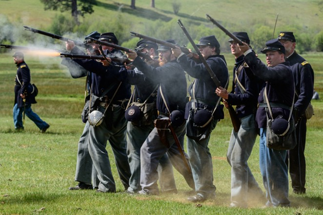 Union soldiers fire away toward Dixie during a reenactment - ZANE HEALY