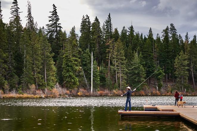 Angler enjoys the newly rebuilt dock at Suttle Lodge. - AJ MEEKER