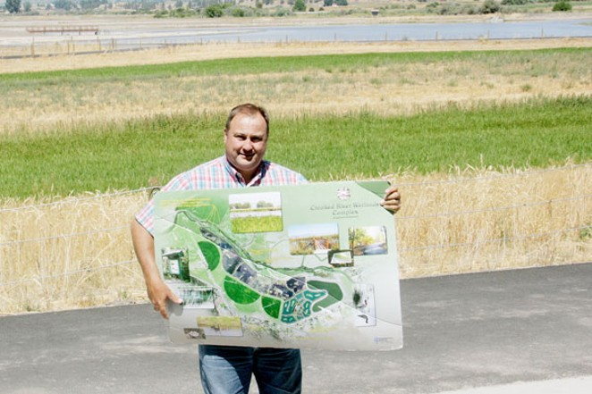 Prineville City Engineer Eric Klann holding a map of his creation, the Crooked River Wetlands Project. - JIM ANDERSON
