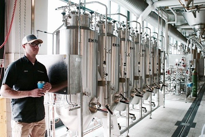 Deschutes Assistant Brewmaster Chris Dent shows off the brewer's R&D testing tanks. - KEVIN GIFFORD