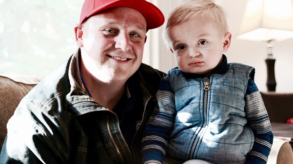 """""""The guys are like his uncles. He loves to play with them, and they love to play with him too."""" Chip, with his son, Beau. - MAGDALENA BOKOWA"""