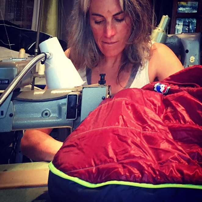 Kinney hard at work at one of her seven industrial sewing machines. - RUGGED THREAD | FACEBOOK