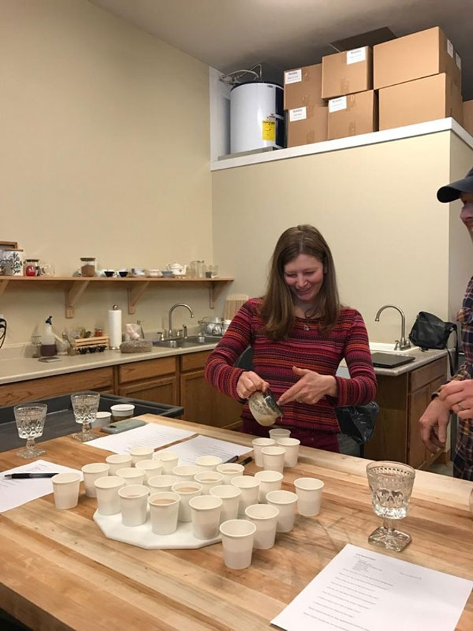 To develop a new chai concentrate Amy Lee Stahl blind tasted lots of different chais. Here she is pouring chai into a blank cup. The name of the producer was listed on the bottom. - METOLIUS TEAS