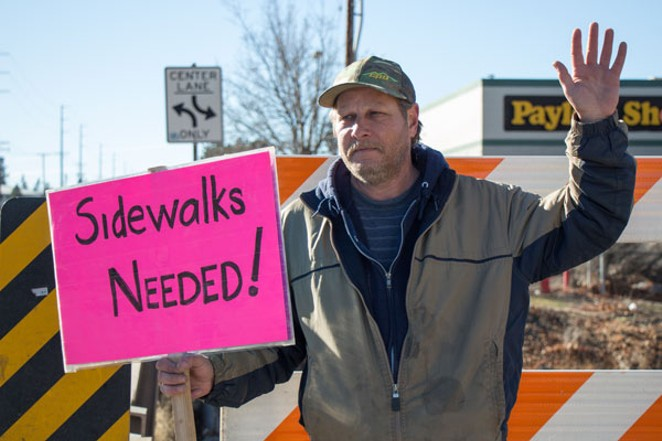 Rob, a volunteer with Advocates for Disabled Americans, Inc., pickets to raise awareness about ADA compliance on 1/13. - KEELY DAMARA