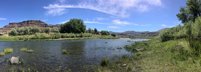 A pastoral view of the John Day River. Below left is the River Bend Motel and the Spray Pioneer Museum at right. - BLM