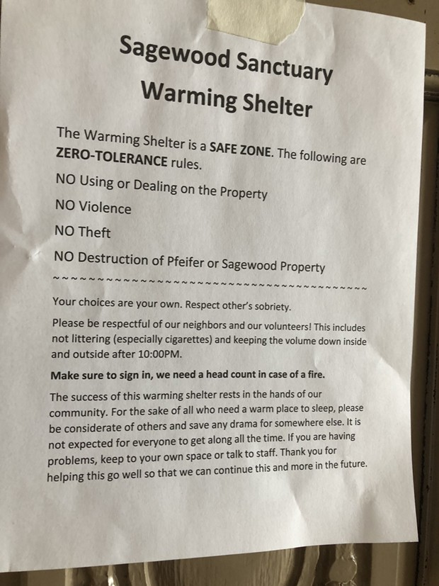 """The """"low barrier"""" or """"low bar"""" shelter posts a few basic rules for attendees. - NICOLE VULCAN"""