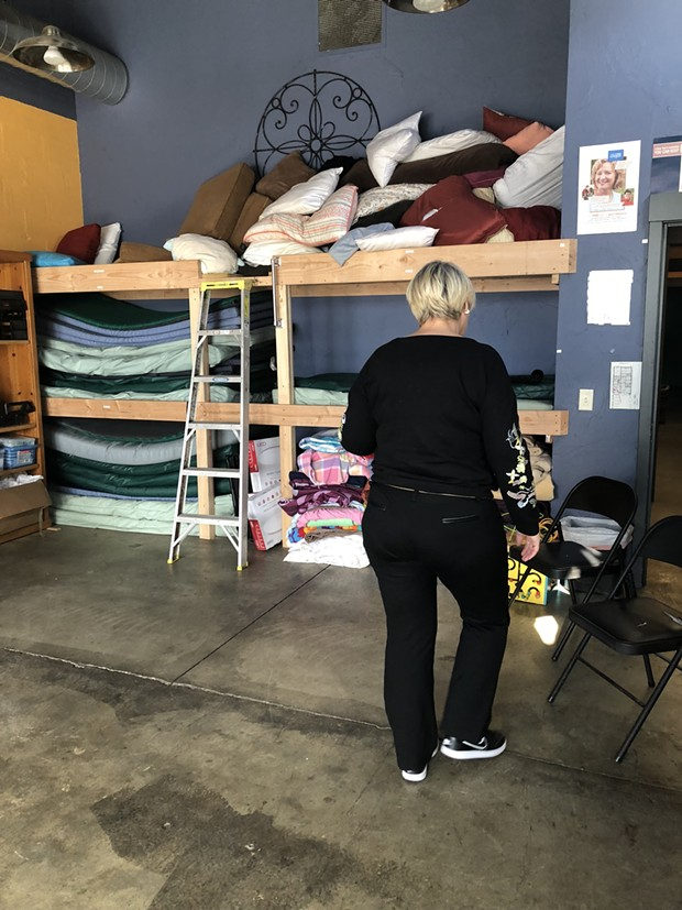 Sally Pfeifer moves chairs around to show off the new bunkbeds in the Sagewood Sanctuary. The room, inside Pfeifer & Associates, is home to group meetings and other support activities during regular business hours. - NICOLE VULCAN