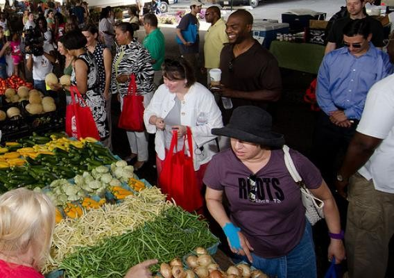People shop at a farmers market in the U.S. Heartland - USDA