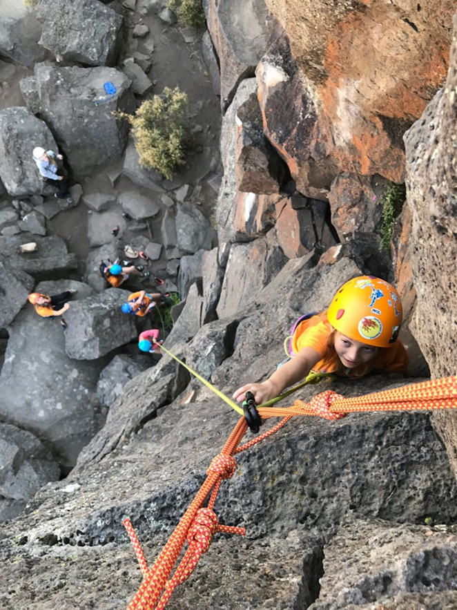 Young girls rope in their confidence on a sheer rock face. - BEND ROCK GYM