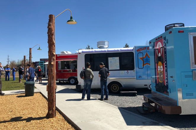 Customers wait for their order at the food truck at On Tap, Bend's newest hangout for food and beer on the East Side. - LISA SIPE