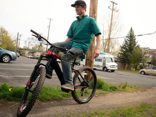 Bend Electric Bike's Rion O'Grady shows off his balancing skills, performing a no-handed trackstand on 5/5. - CHRIS MILLER