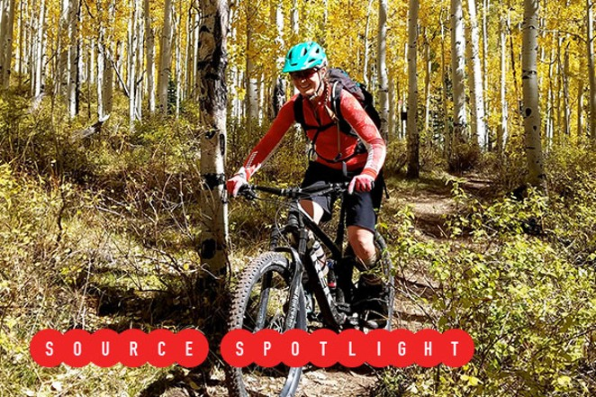 Jane Quinn rides her bike on a dirt trail. - SUBMITTED