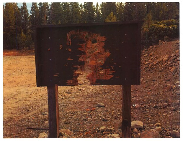 The same sign after being shot to pieces - SISTERS RANGER DISTRICT