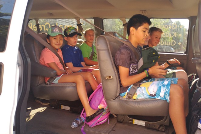 Estrella Aparicio (far left) waits with her paddle classmates to depart for a rafting excursion. - K.M. COLLINS