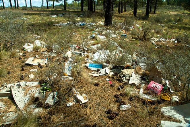 Field of screams: volunteers have their work cut out removing trash from public lands. - JOSH CANTU