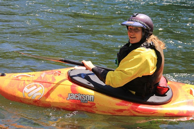 Beth Junkins gets ready to send it on the McKenzie River. - K.M. COLLINS