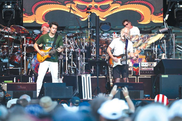 Newbie John Mayer, left, is flanked by original Grateful Dead guitarist Bob Weir, right, and drummers Bill Kreutzmann and Mickey Hart at Saturday's show. - SUBMITTED
