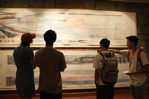Jamaica Sweet, Ryan Martin, Andrew Leung and Clark Miyamoto observing Bill Hoppe's art from the 1970s. - DANIELLE MEYERS
