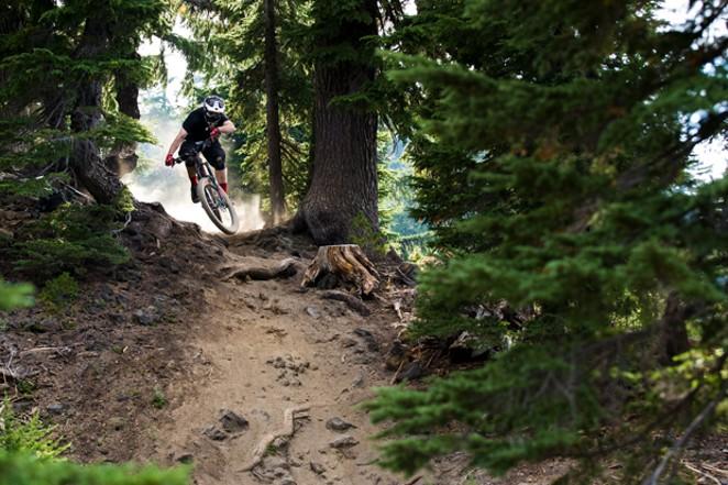 Chris Larro rips up a trail at Mt. Bachelor's Bike Park. - HAMES ELLERBE