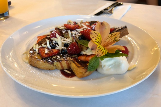 The amaretto French toast is a sweet morning treat but put that beautiful flower in your hair not your stomach. - LISA SIPE