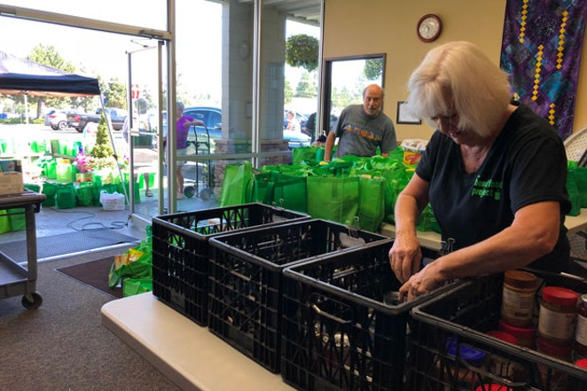 In just a few hours, volunteers collect, sort and send food to The Giving Plate. - LISA SIPE