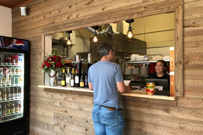 Owner Cristina Rojas serves a customer. - LISA SIPE