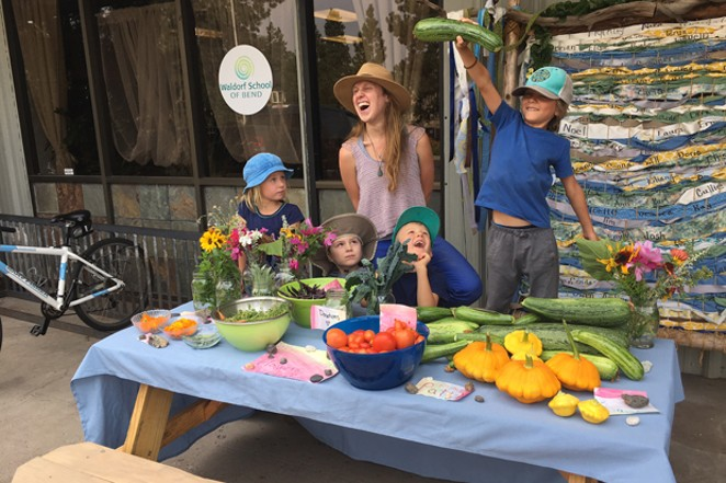 """Kindergarteners from the Waldorf School of Bend staff their own """"farmers market"""" from the school's garden. - WALDORF SCHOOL OF BEND"""