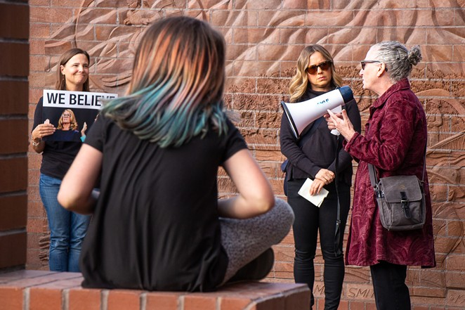 """Stacy Sharlet, 60, speaks to a gathering of more than 100 people at the """"Believe Survivors Rally"""" outside of Bend City Hall Wednesday. - KEELY DAMARA"""