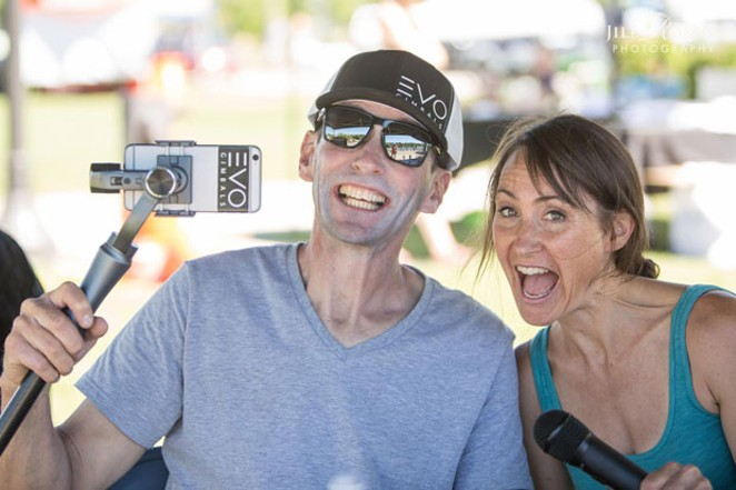 Fox and Jaymo storm the emcee stage at the 2017 Bend Paddleboard Challenge, foreshadowing their future Trail Tales collaboration. - JILL ROSSELL