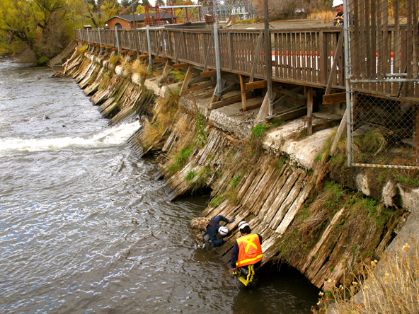 Workers checking out the Newport Avenue Dam in 2013. - SOURCE WEEKLY