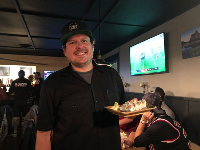 Chef Ian Skomski works solo in the kitchen at the pop up. - LISA SIPE