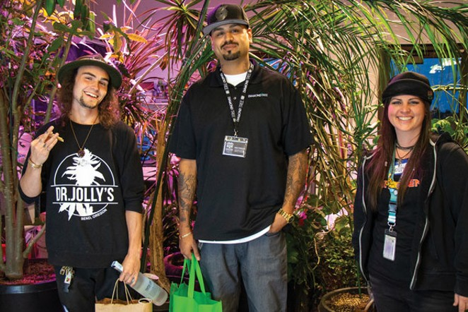 Pritesh Patel the 2018 winner of the budtender contest. Second place went to Hunter Chalker, left, and third place went to Molly Kelly, right. - KEELY DAMARA
