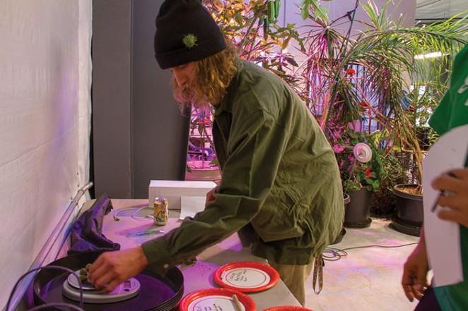 Chase Antonich of High Desert Botanicals tests his eyeball weighing skills. - KEELY DAMARA