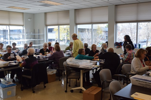 Dozens of volunteers work counting ballots on Election Day. - JACLYN BRANDT
