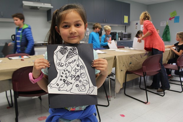 A student displays her artwork from an enrichment activity with Kids Inc. at Juniper Elementary. - BEND PARK AND RECREATION DISTRICT